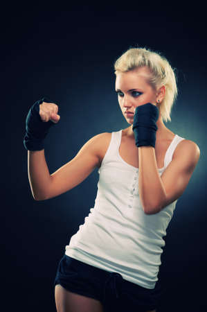 Attractive blonde fighter girl, studio shot, cross processed Stock Photo - 9306029
