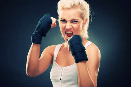 women fighting: Attractive blonde fighter girl, studio shot, cross processed