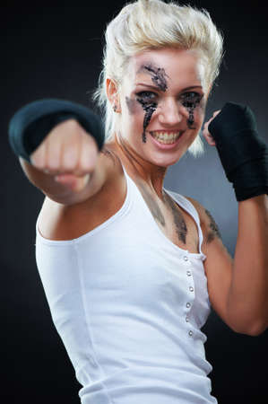 Attractive blonde fighter girl, studio shot, cross processed Stock Photo - 9306071