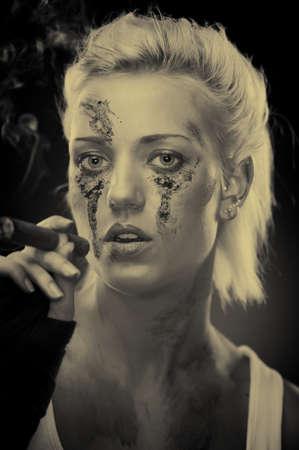Attractive blonde smoker girl, studio shot, sepia photo