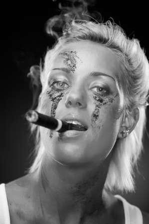 Attractive blonde smoker girl, studio shot, black and white photo