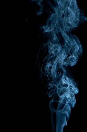 Abstract blueish smoke on black, studio shot