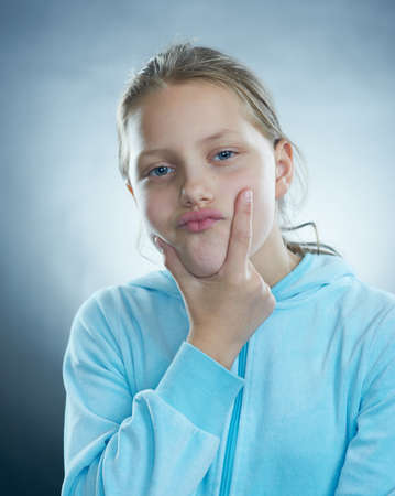 Funny girl with dumb face. Stock Photo - 15866807