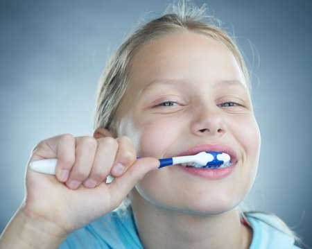 Little girl brushing her teeth. photo