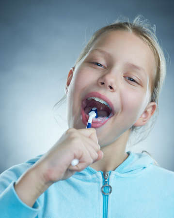 Little girl brushing her teeth. photo