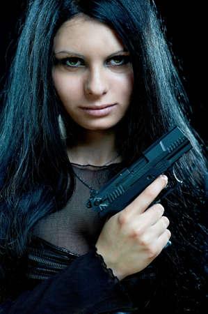 sexy army: beautiful goth girl with gun on black Stock Photo