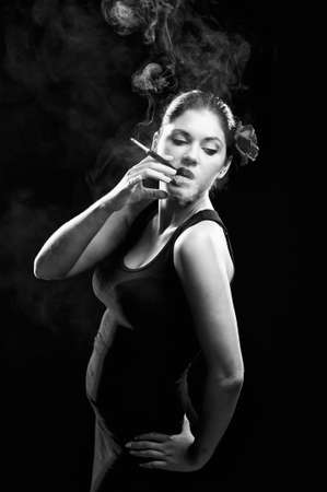 Sexy looking spanish women smoking cigarette with red rose photo