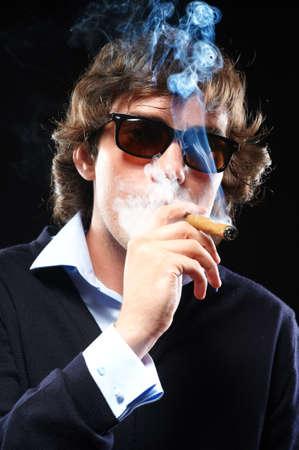 Closeup portrait of a smoking man with cigar Stock Photo