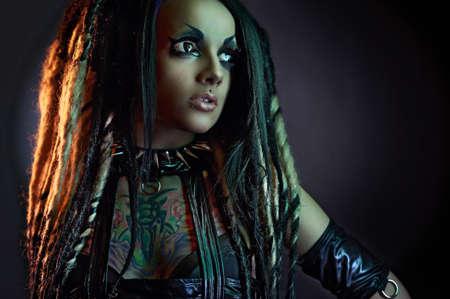 Beautiful demon girl with black eyes, studio shot