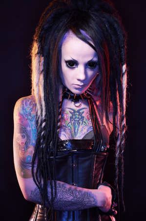 Beautiful demon girl with black eyes, studio shot photo