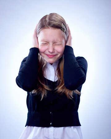 Portrait of a surprised teen girl, studio shot
