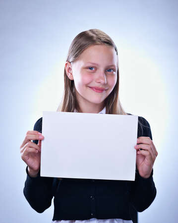 Portrait of a happy teenage girl with a blank board, studio shot photo