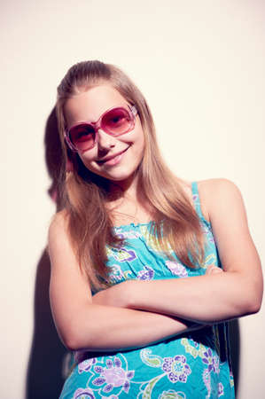 contrasty: Contrasty portrait of a teen girl with sunglasses Stock Photo