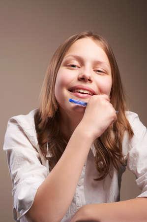 Portrait cute smiling teen schoolgirl photo