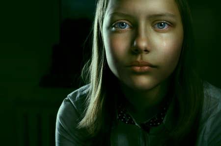 Portrait of a depressed teen girl, studio shot photo