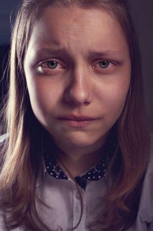 Portrait of a depressed teen girl, studio shot Standard-Bild