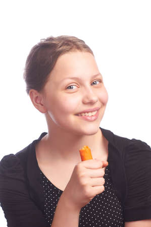 ten girl eating carrot,studioshot photo