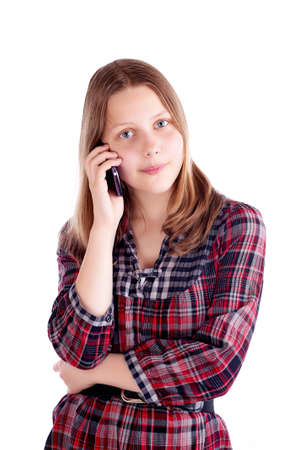 Happy teen girl talking on mobile phone, studio shot photo
