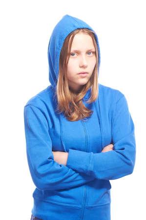Angry teen girl in hood, studio shot