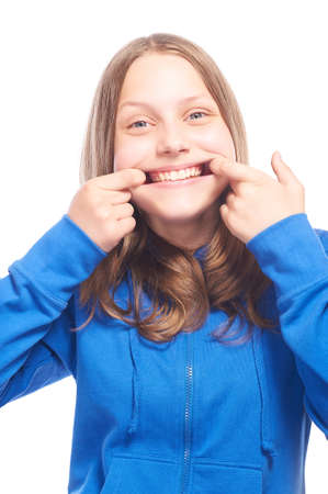 funny faces: Happy teen girl making funny faces, studio shot Stock Photo