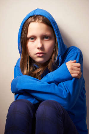 Afraided teen girl, studio shot Standard-Bild