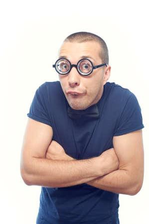Nerd guy in eyeglasses and bow tie hugging himself