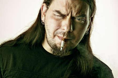 Rocker man with bad habit smoking Stock Photo