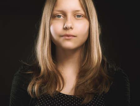 Sad teen girl, studio shot