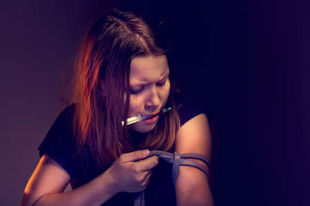 methamphetamine: Teen girl addict with syringe