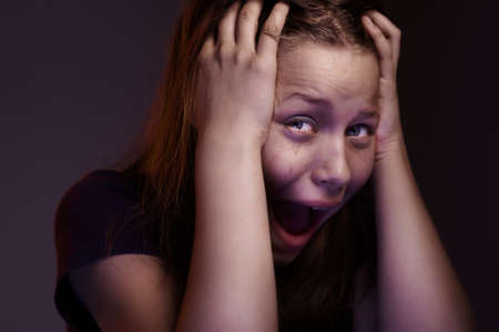 Afraided teen girl experiences fear Stock Photo