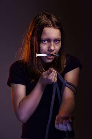 Teen girl addict with syringe