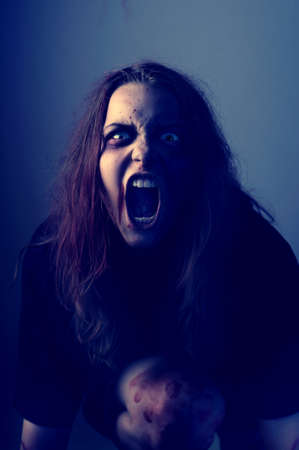 Mad possessed by a demon girl shouting Stock Photo