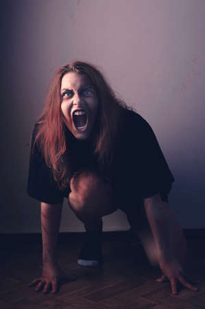 damnation: Mad possessed by a demon girl shouting Stock Photo