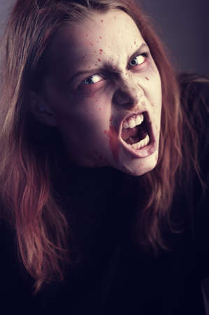 necromancy: Mad possessed by a demon girl shouting Stock Photo