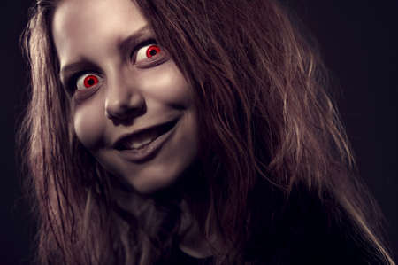 Close up portrait of evil girl possessed by a demon photo