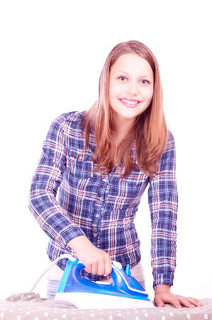 clothes interesting: Portrait of a happy beautiful smiling teen girl ironing clothes Stock Photo