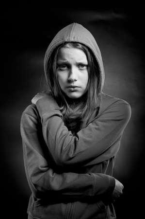 Afraided, sad teen girl in hood Standard-Bild