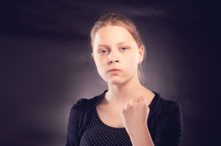 Angry teen girl badly gesturing Stock Photo