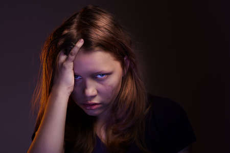 hatred: Angry crazy teen girl looking with hatred in her eyes