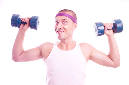 Portrait of a nerd guy trains with dumbbells photo