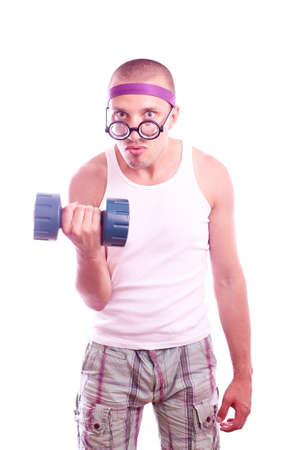 Portrait of a silly nerd in glasses with dumbbell trains photo