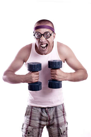 stupid body: Portrait of a silly nerd in glasses with dumbbell trains Stock Photo