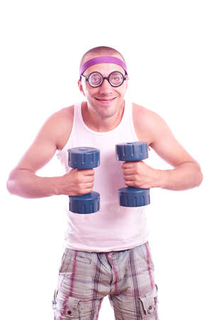 Portrait of a silly nerd in glasses with dumbbell trains Standard-Bild