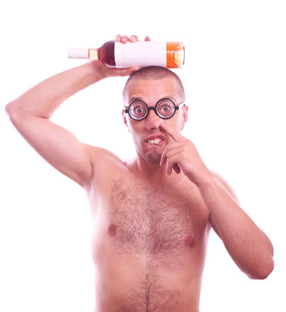 nose picking: Portrait of a drunk  nerd in eyeglasses with bottle picking his nose