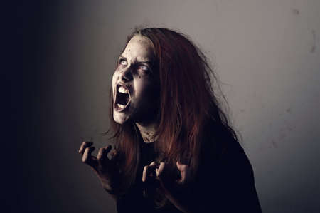 possessed: Mad possessed by a demon girl shouting Stock Photo