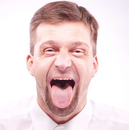 Portrait of a man with his tongue out photo