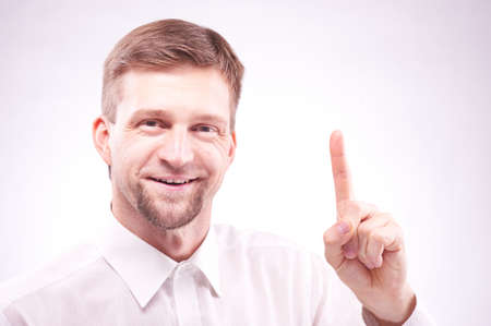 Thinking man has idea. Portrait on a white background photo