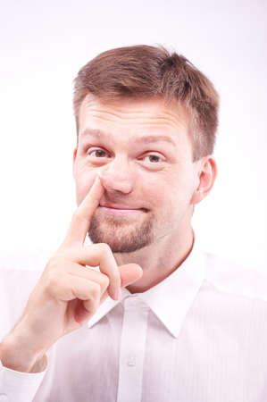 nose picking: Portrait of a happy silly man picking his nose