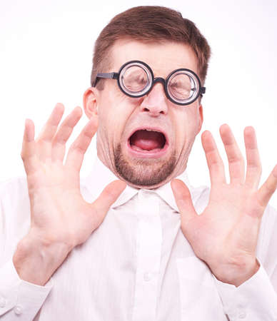 dismay: Portrait of an afraid man in glasses Stock Photo