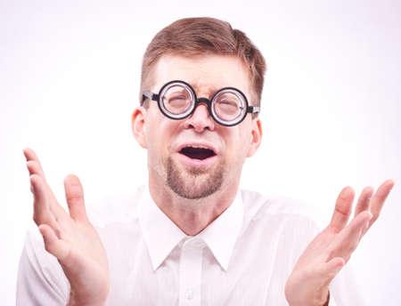 appalled: Portrait of an afraid man in glasses Stock Photo